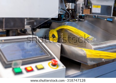 Image of machine for cutting and crimping wires