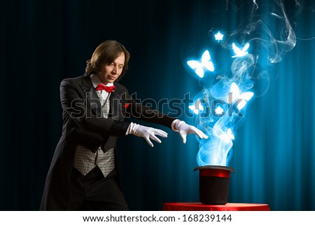 Image of magician showing tricks with magic hat