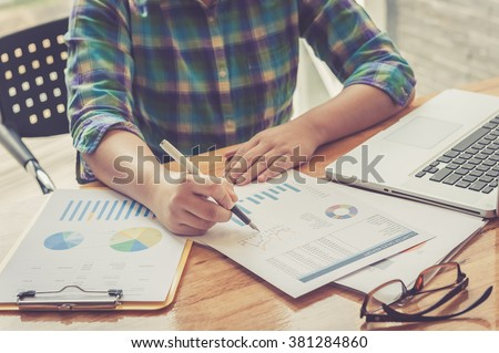 Image of male hand with business document - stock photo