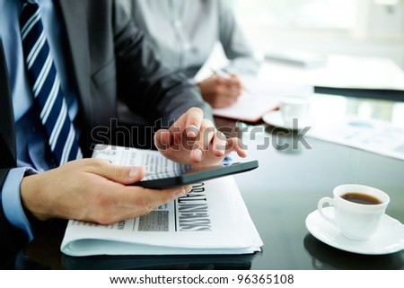Image of male hand with digital tablet touching its screen - stock photo