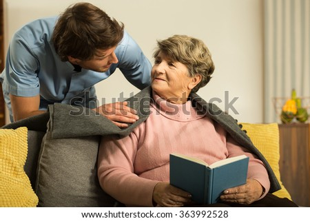 Image of male private carer and his patient - stock photo