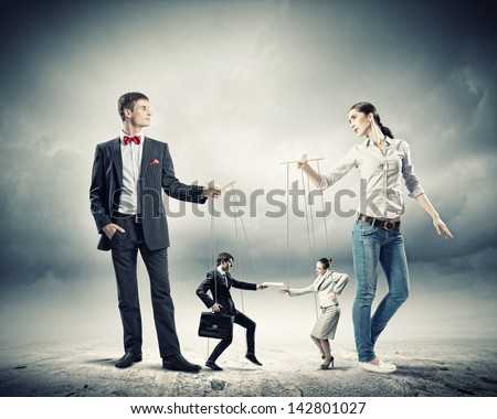 Image of man and woman with marionette puppets