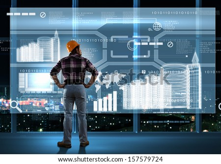 Image of man builder looking at media screen - stock photo