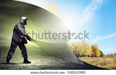 Image of man in gas mask turning page. Ecology concept - stock photo