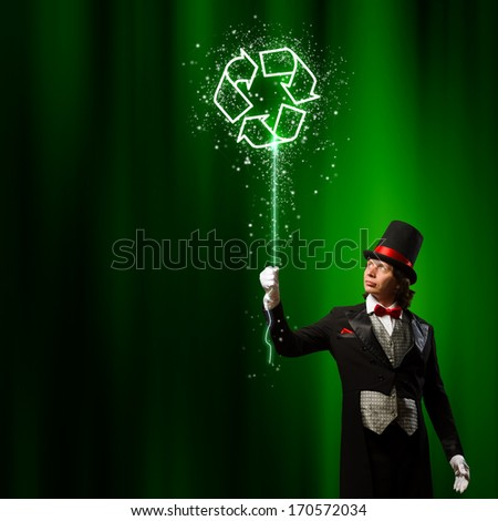 Image of man magician against color background. Recycle concept - stock photo
