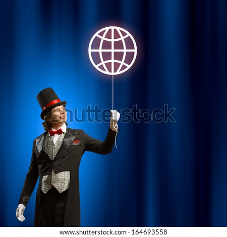 Image of man magician with balloon against color background - stock photo