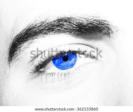 Image of man's blue eye close up.