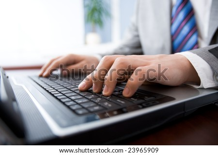 Image of man?s hands pushing buttons of keyboard in the office - stock photo