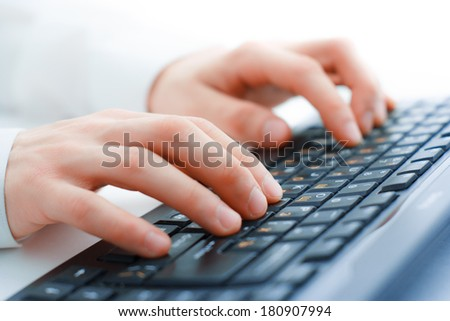 Image of man's hands typing. Selective focus - stock photo