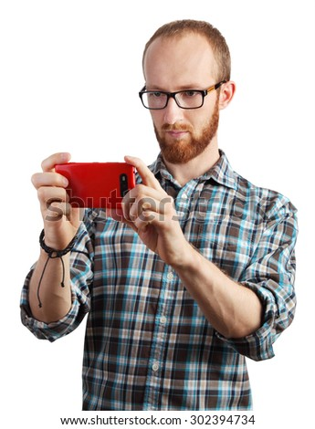 Image of man taking pictures with his smartphone isolated on white - stock photo