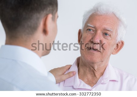 Image of man talking with senior father