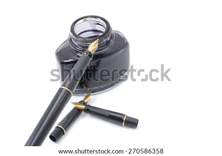 image of manuscript pen with opened black ink bottle, three extra nibs - stock photo