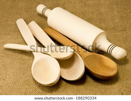 image of many wooden spoons and rolling pin - stock photo