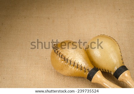 Image of maracas a latin percussion on brown sack background