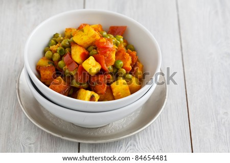 Image of mattar paneer, an Indian vegetarian dish with  paneer and peas in a spicy sauce.