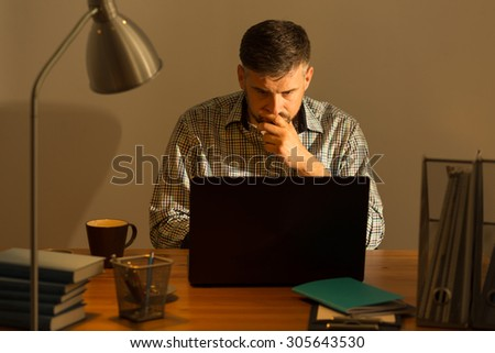 Image of mature man working at home - stock photo