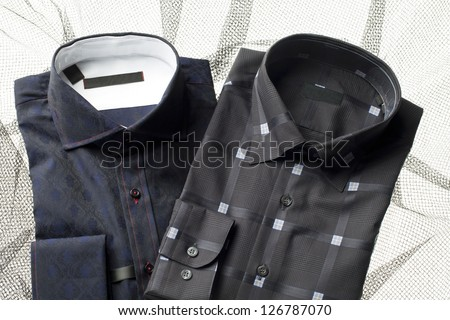 Image of men's shirts on printed background - stock photo
