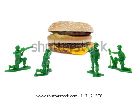 Image of military toy soldiers targeting the hamburger over white background - stock photo