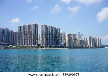 Image of modern apartment building near a lake under blue sky - stock photo