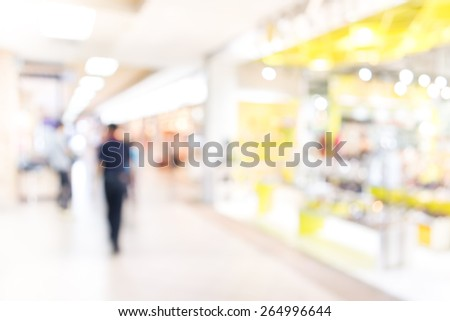 image of Motion Blurred People in the Shopping Mall. - stock photo