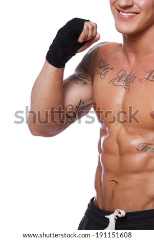 Image of muscle fighter posing in studio