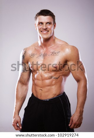 Image of muscle man posing in studio - stock photo