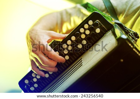 Image of musician playing on accordion closeup - stock photo