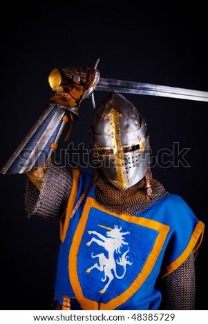 Image of noble knight slashing with sword - stock photo
