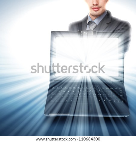 Image of notebook with shining screen and light - stock photo