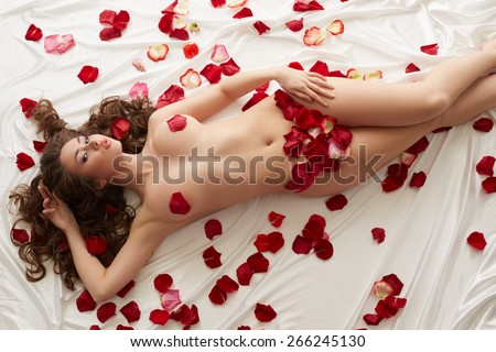 Image of nude beautiful woman with rose petals - stock photo