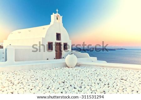 image of oia, Santorini at sunrise - stock photo