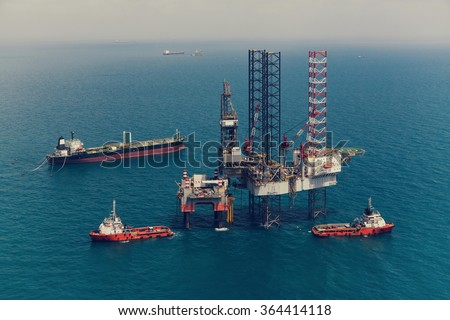 Image of oil platform while cloudless day(color tone) - stock photo