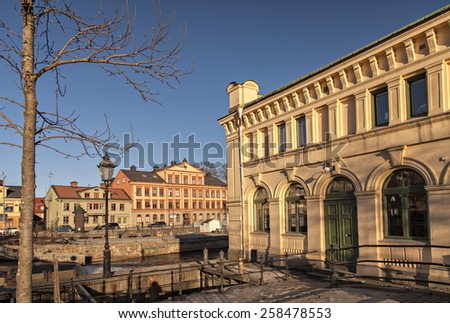 Image of old buildings in the centre of Uppsala, by the river.