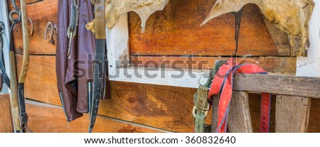 image of old chair and horse riding equipment . - stock photo
