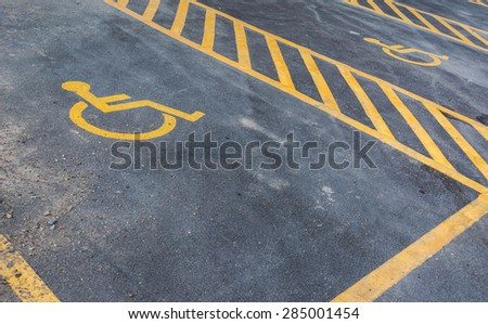 image of old Handicapped symbol on parking space . - stock photo