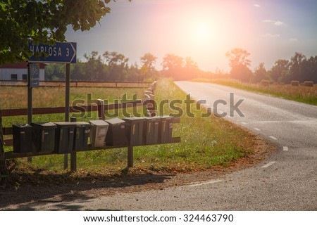 Image of old postboxes on a countryside road. South Sweden.  - stock photo