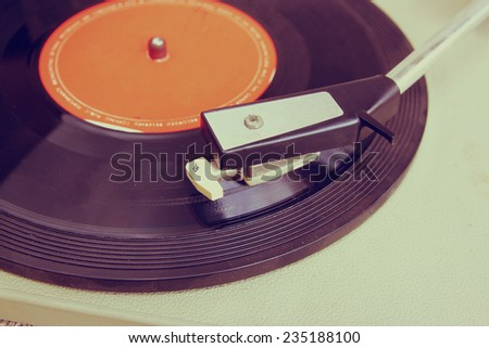 image of old record player, image is retro filtered . selective focus  - stock photo