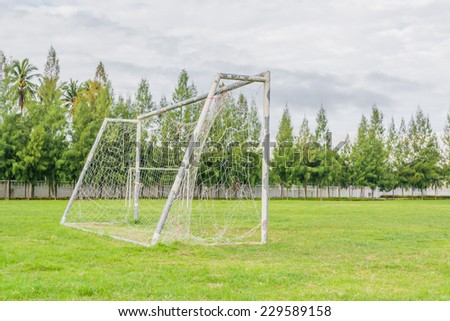 image of old soccer goal in field. - stock photo