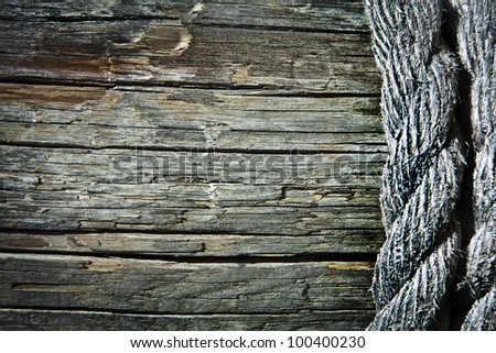 Image of old texture of wooden boards with ship rope - stock photo