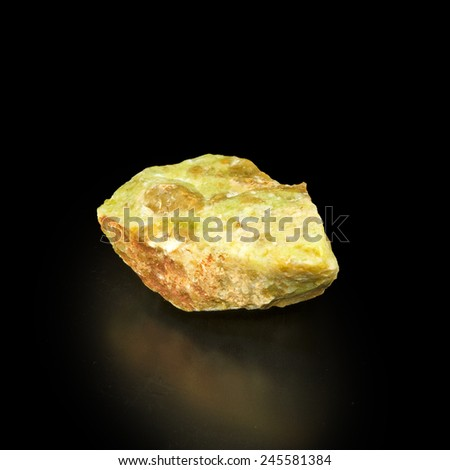 image of one opal stone on a black background - stock photo