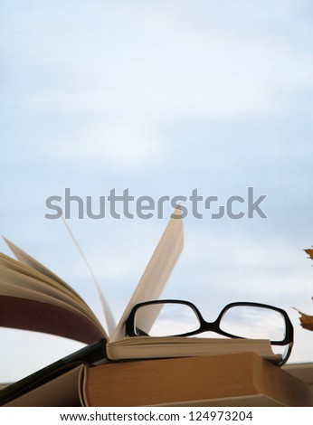 image of open book and glasses - stock photo