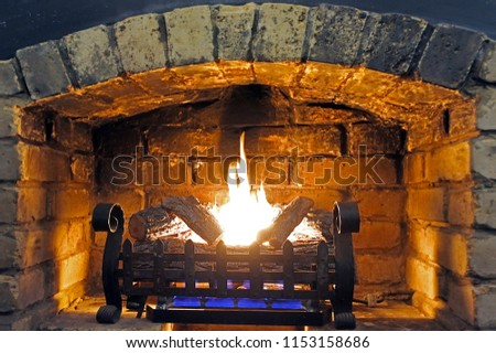 Image of open fireplace and wood burning at home on a cold winter day.