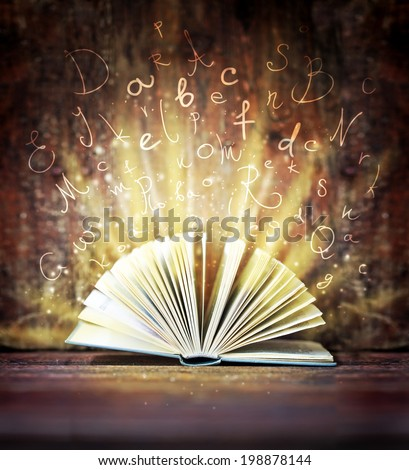 "Image of opened magic book with magic lights/ ""Back to school""background/ Education concept background"