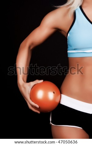 image of orange fitness ball in girls hands