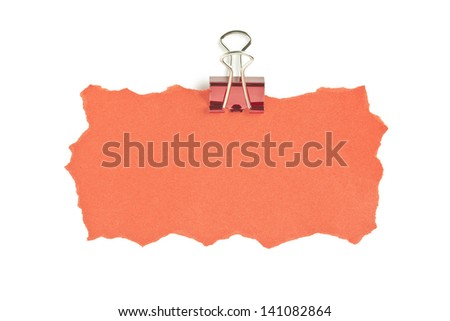 Image of orange paper with paper clip against white background - stock photo