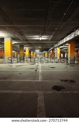 Image of parking garage underground interior, dark industrial building, modern public construction