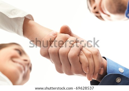 Image of partners handshake after signing contract - stock photo