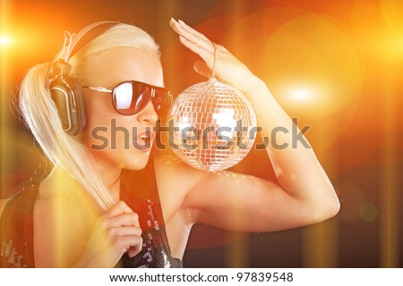 Image of party girl on the stage with discoball - stock photo