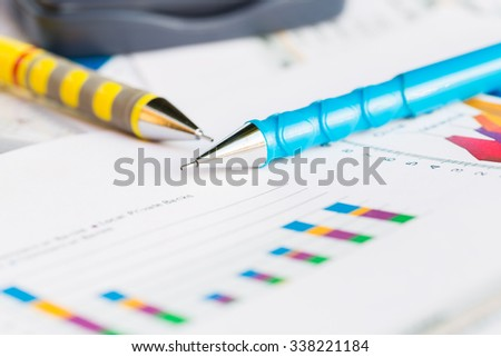 Image of pencil and Graph business document - stock photo