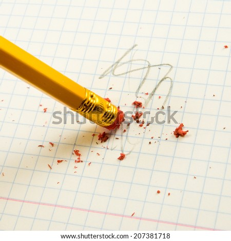 image of pencil with eraser on exercise book  background - stock photo